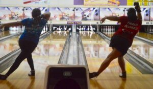 Yarelis Alvarez and Aileen Linares bowling in sync